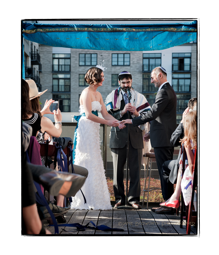 Exchanging-rings-on-the-Ecotrust-roof-Jamie-Bosworth-Photographer